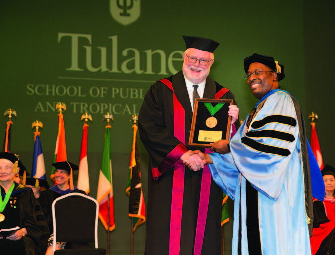 Dean Thomas LaVeist honors previous dean Dr. Pierre Buekens